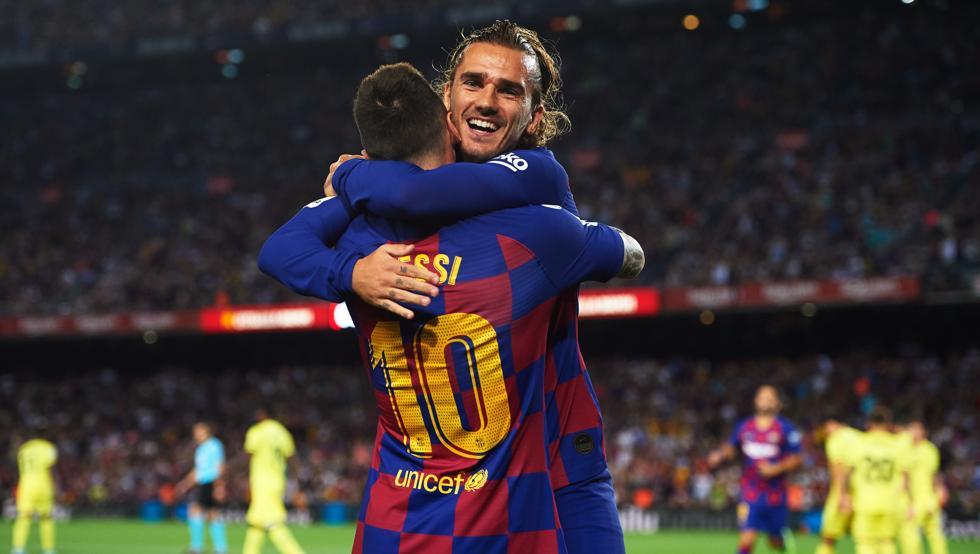 Antoine Griezmann junto con Lionel Messi
