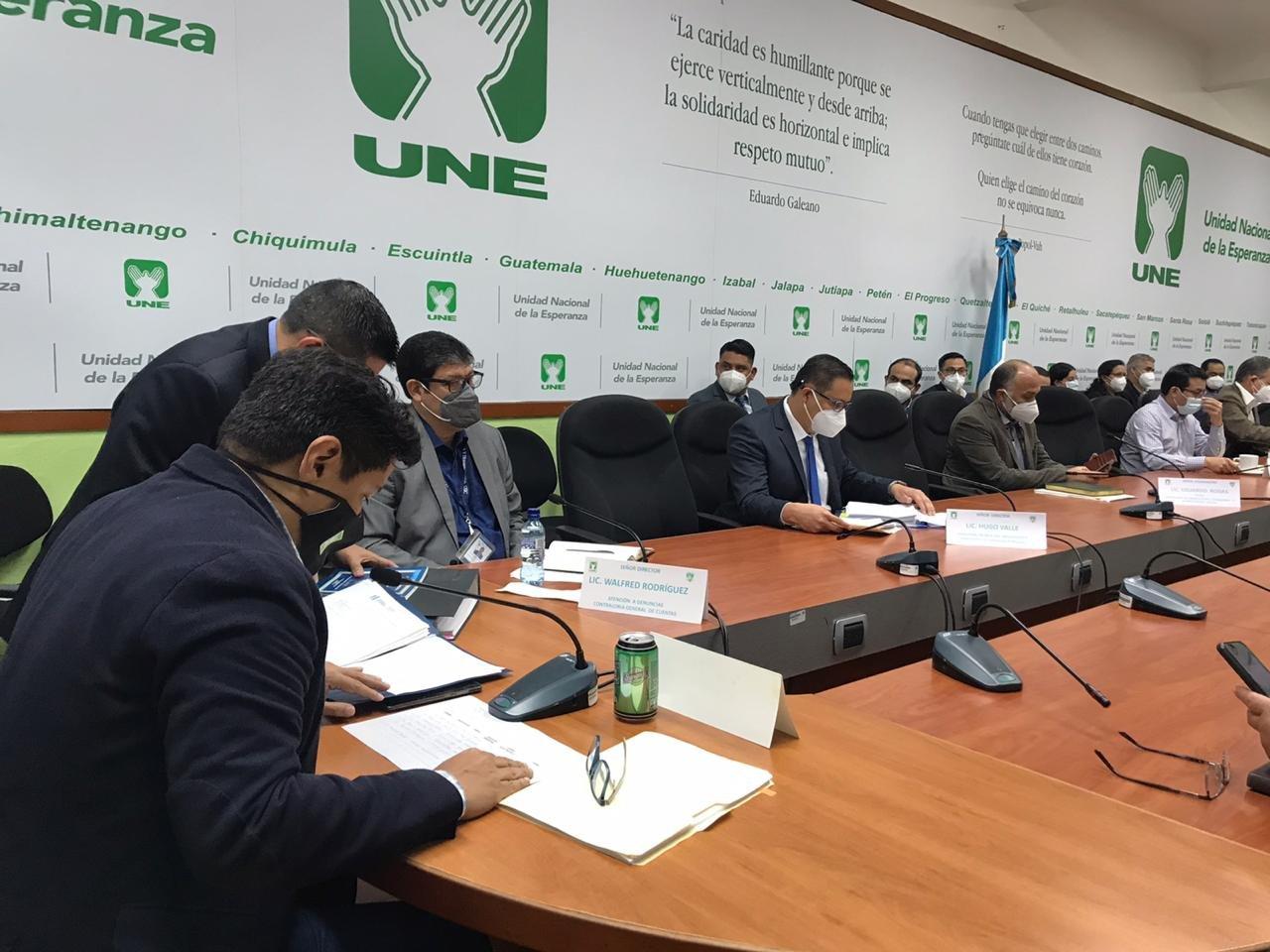 citación de UNE con funcionarios por programas de Covid-19